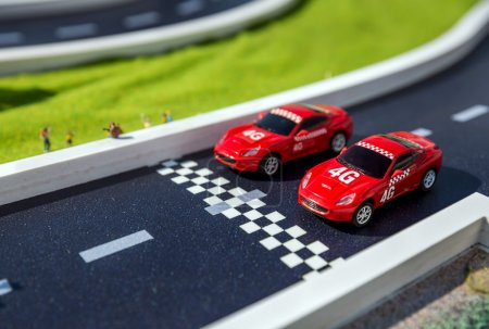 Two red toys racing cars