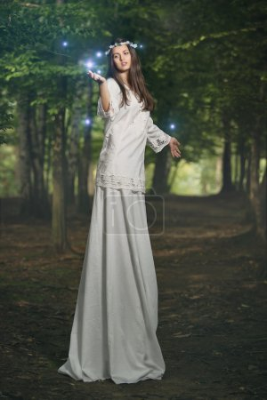 Fairy woman in magical forest