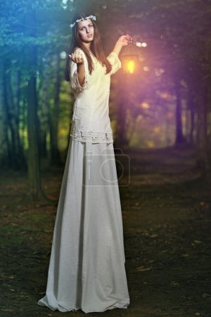 Fairy beautiful woman in magical forest