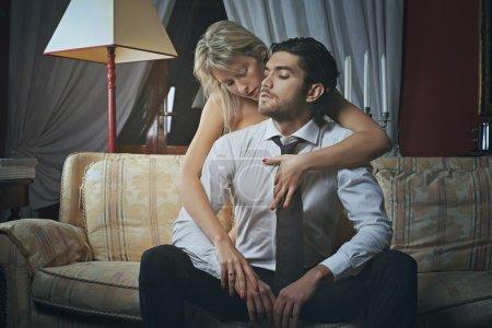 Beautiful woman undressing fashion elegant man