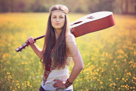 Beautiful hippie woman with guitar