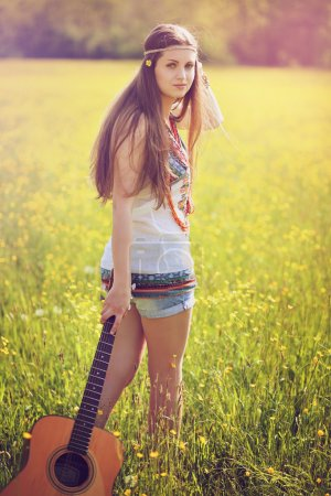 Summer portrait of hippie woman with guitar