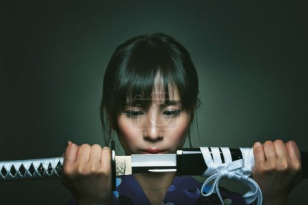 Beautiful japanese woman with samurai sword