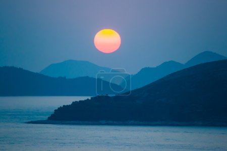 Photo for Sunset over sea and mountains a blue evening - Royalty Free Image