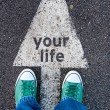 Green shoes standing on your life sign...