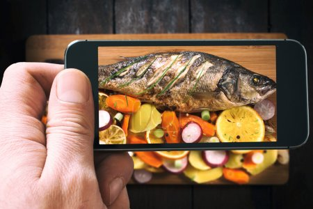 Bass fish with vegetables and fruit