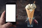 Ice cream with cookies with blank space on phone