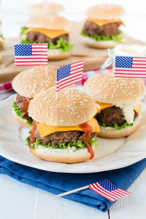 beef burgers with cheese and USA flags