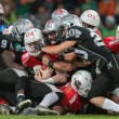 Постер, плакат: Raiders vs Lions football game