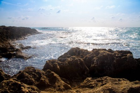 Photo for On a sunny day, blue sky with clouds, rocks and sea - Royalty Free Image