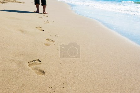 Photo for Footprints of a man walking on the beach - Royalty Free Image