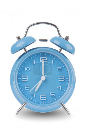 Blue alarm clock with the hands at 7 am or pm isolated on a white background, One of a set of 12 images showing the top of the hour starting with 1 am / pm and going through all 12 hours