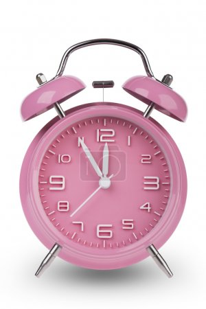 Pink alarm clock with the hands at 5 minutes till 12. Illustrating Time is Running Out isolated on a white background