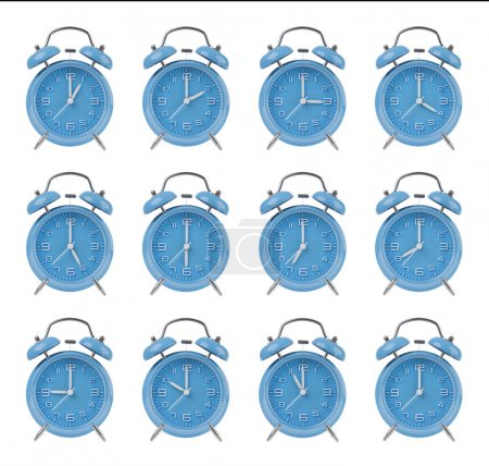 Twelve blue alarm clocks showing the top of each hour isolated on a white background