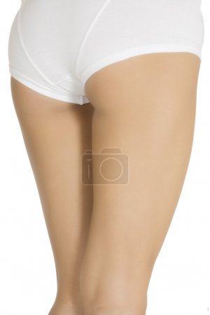 Sexy legs of a young caucasian woman isolated on white backgroun