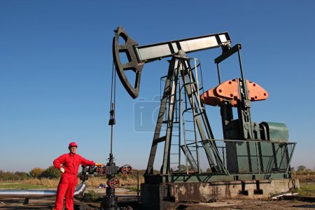 Oil Rig and Laborer