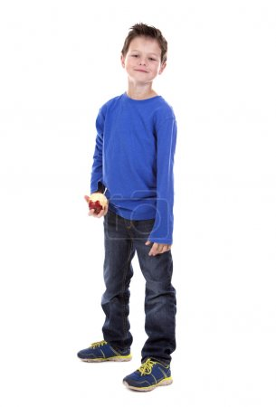 thrilled boy holding and apple