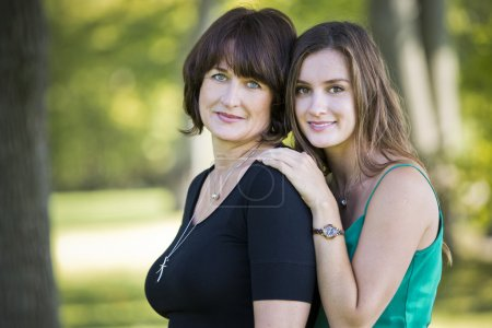 Photo for Caucasian mother and daughter together in the park - Royalty Free Image