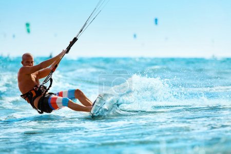 Recreational Sports. Man Kiteboarding In Sea Water. Extreme Sport