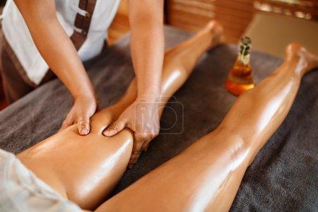 Spa Woman. Oil Leg Massage Therapy, Treatment. Body Skin Care