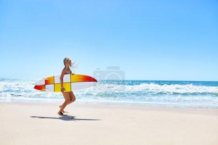 Summertime. Surfing. Summer Sport. Woman With Surfboard Running