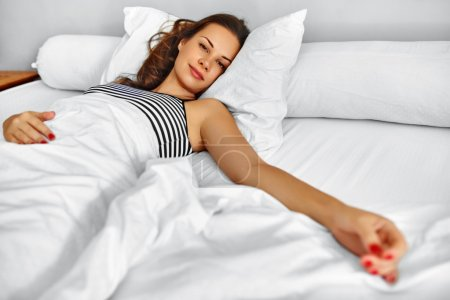 Morning. Healthy Woman After Wake Up Relaxing In Bed. Wellness