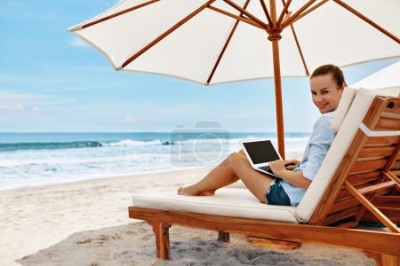 Photo for Work At Beach. Successful Freelancer Business Woman Working Online In Internet On Laptop Computer, Typing On Keyboard Relaxing By Sea. Freelance Outdoors Work. People Communication, Technology Concept - Royalty Free Image
