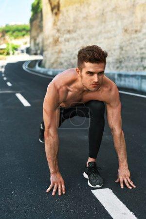 Sprinter Man On Start , Ready To Run Outdoors. Running Sports