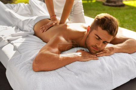Spa Massage For Man. Male Enjoying Relaxing Back Massage Outdoor