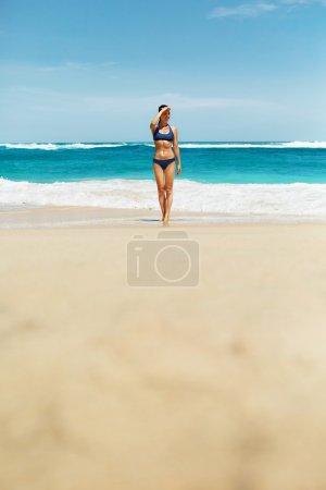Beautiful Woman In Sexy Bikini On Beach In Summer.
