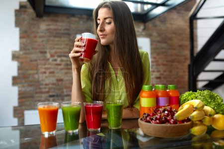 Photo for Fitness Food. Healthy Eating Woman On Diet Drinking Fresh Detox Juice, Smoothie For Breakfast. Closeup Of Beautiful Smiling Girl With Fruits And Weight Loss Drinks At Kitchen Table. Nutrition Concept - Royalty Free Image