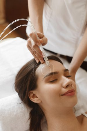 Facial Beauty Treatment. Woman Getting Oxygen Water Skin Peeling