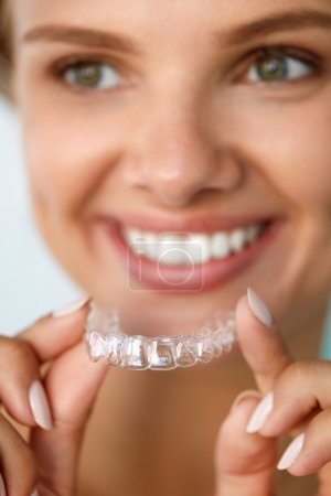 Smiling Woman With White Teeth Holding Teeth Whitening Tray