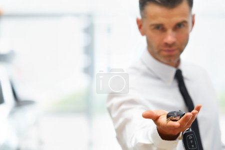 Car Salesman Giving Key of New Car