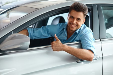 Photo for Car Showroom. Happy Man inside Car of His Dream. - Royalty Free Image