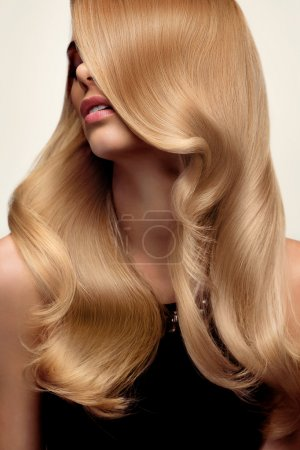 Photo for Blond hair. Portrait of beautiful Blonde with Long Wavy Hair. High quality image. - Royalty Free Image