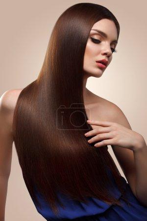 Hair. Portrait of Beautiful Woman with Long Brown Hair. High qua