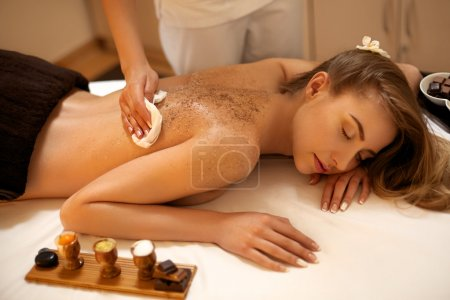 Body Scrub. Beautiful Blonde Gets a Salt Scrub Bea...