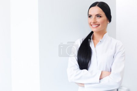 Dentist Portrait. Woman Smiling at her Workplace. Dental Clinic