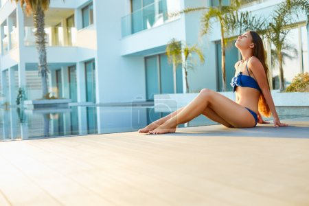 Woman relaxing in spa and resort hotel.