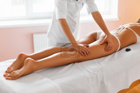 Spa woman. Body care. Legs massage in spa salon