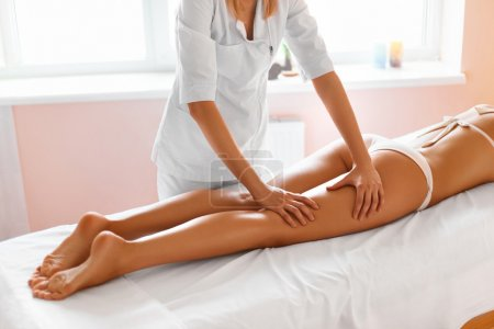 Body care. Legs massage in spa salon