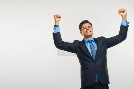 Photo for Business Man Celebrating Success against White Background - Royalty Free Image