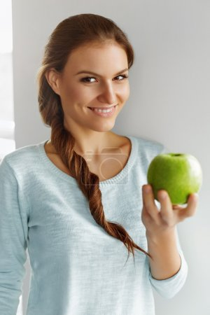 Photo for Healthy Food. Beautiful Happy Young Woman With Fresh Green Apple. Healthy Eating. Fruits. Diet. Dieting Concept. Healthy Lifestyle Concept. - Royalty Free Image