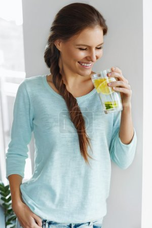 Healthy Food. Woman Drinking Lemon Detox Water. Healthy Eating.