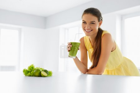 Healthy Woman  Drinking Green Detox Juice. Lifestyle, Food, Drinks, Diet