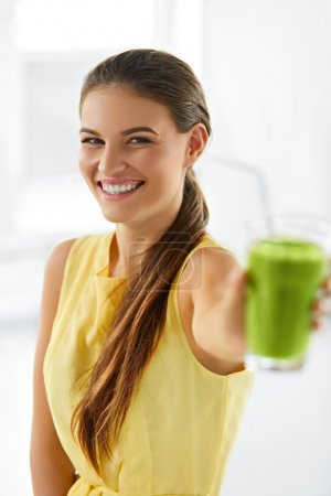 Photo for Nutrition. Healthy Eating Smiling Woman Holding Glass Of Fresh Raw Green Detox Vegetable Juice. Healthy Lifestyle, Vegetarian Diet And Meal. Drink Smoothie. - Royalty Free Image