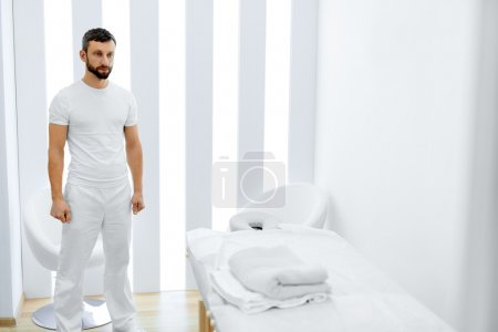 Body Care. Masseur In Spa Salon. Physical Therapist. Massage The