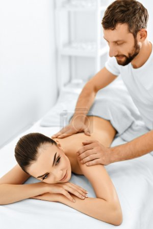 Spa Woman. Massage Procedure In Beauty Spa Salon. Body Care.