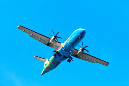 Travel Thailand. Aircraft ( Propeller Plane ) Flying In Sky. Tou